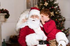 Santa claus and little boy royalty free stock photos