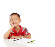 Portrait of little boy thinking. And look up to copy space against white background royalty free stock images