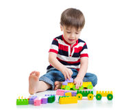 Portrait of little boy with toy blocks Stock Photo
