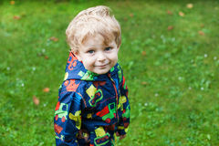 Portrait of little boy two years old on rainy day Stock Photos