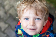 Portrait of little boy two years old on rainy day royalty free stock photography