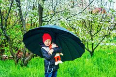 Portrait of a boy with an umbrella on a spring walk royalty free stock photos