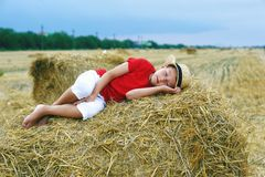 Portrait of a little boy on vacation in the field . The child lying in the manger stock images
