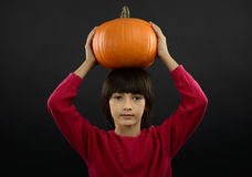 Portrait of little boy wearing halloween costume with pumpkin on Royalty Free Stock Photo