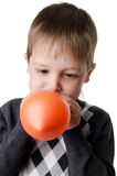 Portrait of a little boy, which inflates the balloon Royalty Free Stock Photo