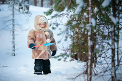 Portrait of a little boy in a winter forest Stock Images