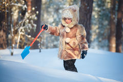 Portrait of a little boy in a winter forest Royalty Free Stock Photography