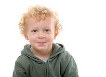 Portrait of a little boy of 3 years with a green coat Stock Photo