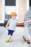 Portrait of little builder in hardhats with hammer working outdoors. Childhood concept Stock Photography