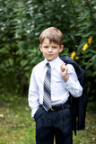 Portrait of little businessman on nature Royalty Free Stock Photo