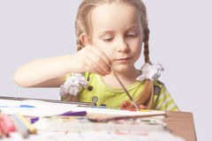 Portrait of little caucasian blond girl drawing Royalty Free Stock Photos