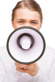 Portrait of little caucasian girl speaking on megaphone.isolated Royalty Free Stock Photography