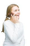 Portrait of little caucasian girl talking on mobile phone Royalty Free Stock Image