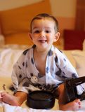 Portrait of a little cheerful baby wearing a traditional yukata in a ryokan`s room in Takayama city stock photos
