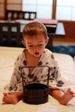 Portrait of a little cheerful baby wearing a traditional yukata in a ryokan`s room in Takayama city royalty free stock photos