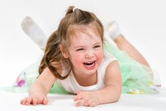 Portrait of a little cheerful girl. The child laughs Royalty Free Stock Photos