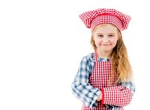 Portrait of a little chef girl isolated on a white backgroung. Portrait of a little chef girl in red uniform isolated on a white backgroung Royalty Free Stock Photography