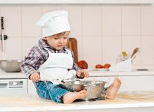 Portrait of a little chef hat and apron Royalty Free Stock Photos