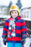 Portrait of little child in colorful clothes in winter, outdoors Royalty Free Stock Photography