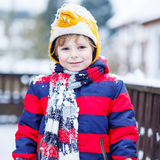 Portrait of little child in colorful clothes in winter, outdoors Royalty Free Stock Image