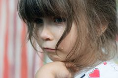 Portrait of little child crying with tears rolling down her cheeks stock photos