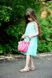 Portrait of little child girl checking her bag Royalty Free Stock Image