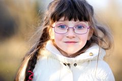 A portrait of little child girl in glasses Stock Image