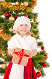The portrait of the little child smiling and holding present box Royalty Free Stock Photography