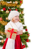 The portrait of the little child smiling and holding present box Royalty Free Stock Photos