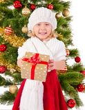 The portrait of the little child smiling and holding present box Stock Image