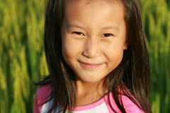 Portrait of little Chinese girl. In summer time Royalty Free Stock Photos