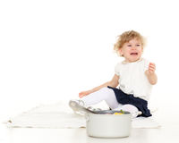 Portrait of little crying  girl. Unhappy crying little child sits on the floor on a white background Royalty Free Stock Image