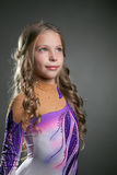 Portrait of little curly artistic gymnast Royalty Free Stock Photography