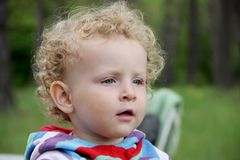 Portrait of little curly girl Stock Photos