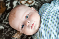 Portrait of little cute baby with blue eyes Royalty Free Stock Photography