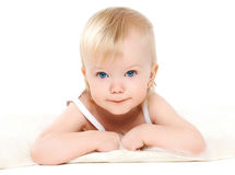 Portrait little cute baby lying on a white Royalty Free Stock Photos