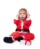 Portrait of little cute baby in red suite Stock Images