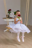 Portrait of little cute ballerina on swing Royalty Free Stock Photos