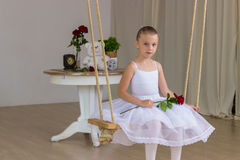 Portrait of little cute ballerina on swing Royalty Free Stock Images