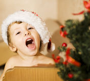 Portrait of little cute boy in Christmas in red Stock Photography