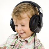 Portrait of little cute boy in earphones Stock Photo