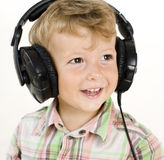 Portrait of little cute boy in earphones Royalty Free Stock Images