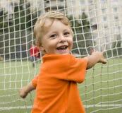 Portrait of little cute boy on football field Royalty Free Stock Photo