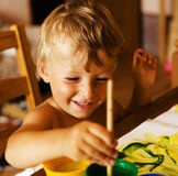Portrait of little cute boy painting at home Royalty Free Stock Images