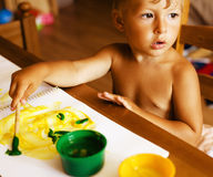 Portrait of little cute boy painting at home Stock Photo