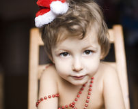 Portrait of little cute boyl with Christmas tree in hat Royalty Free Stock Photos