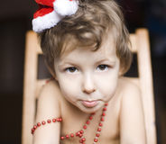 Portrait of little cute boyl with Christmas tree in hat Royalty Free Stock Photo