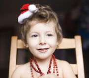 Portrait of little cute boyl with Christmas tree in hat Royalty Free Stock Photography