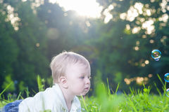 Portrait of Little Cute Caucasian Boy Playing With Soap Bubbles. Outdoors. Horizontal Image Composition Royalty Free Stock Image
