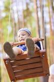Portrait of Little Cute Caucasian Boy on Swing Royalty Free Stock Photos